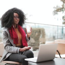 a picture of a woman looking at various way to access capital for her small business